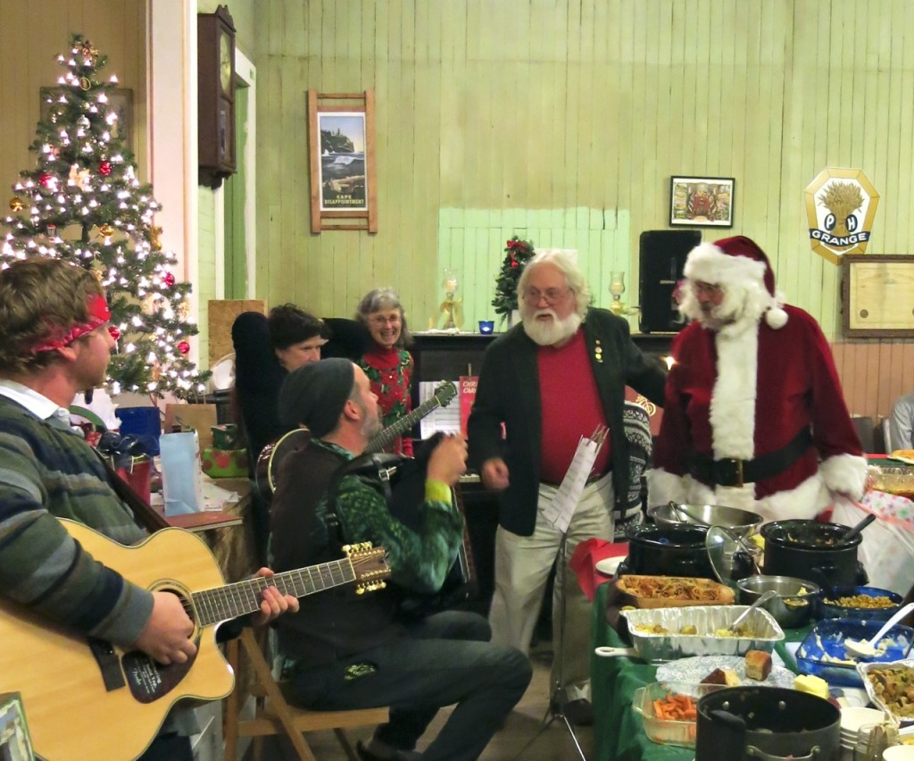 Bob Pyle drags Santa over to meet the band.